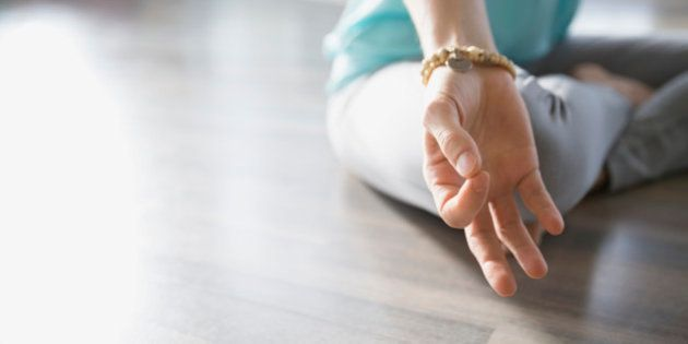 Close up of woman practicing mudra