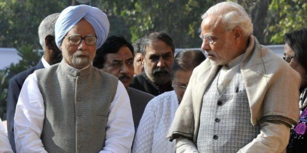 NEW DELHI, INDIA - DECEMBER 13: Prime Minister Narendra Modi and former Prime Minister Manmohan Singh...