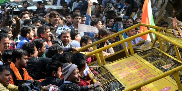 Indian right-wing activists try to break down a barricade outside Jawaharlal Nehru University (JNU) in...