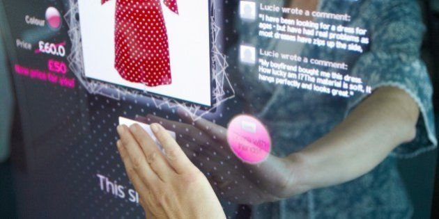 Interactive mirror that allows the person standing in front of it to see a simulated view of how the...