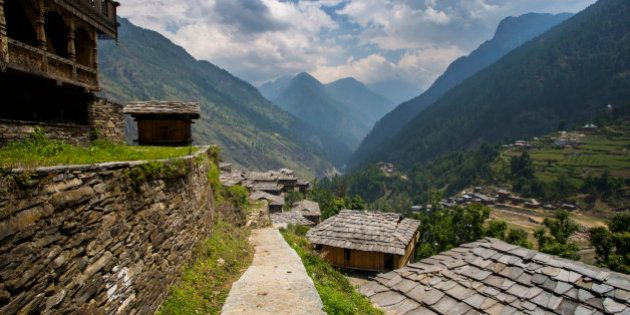 Uniquely roofed slate tiled roofs in the village of Kunwar along the border of Govind National Park in...