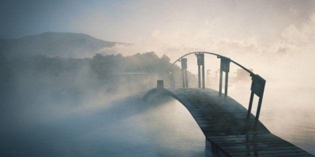 Bridge covered in fog in