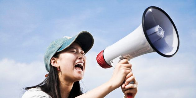 portrait of young japanese woman shouting through