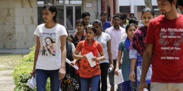 NOIDA, INDIA - MAY 1: Medical aspirants coming out of the examination hall after appearing the All India...