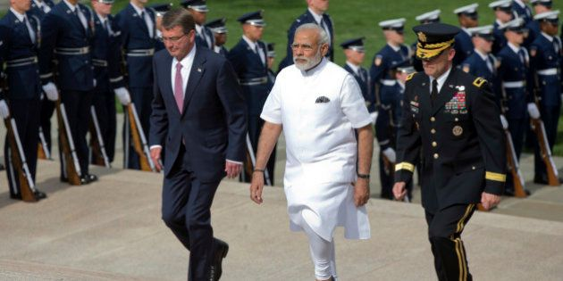 Indian Prime Minister Narendra Modi, center, with Secretary of Defense Ash Carter, left, and, Maj. Gen....