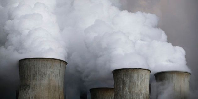 Steam rises from the cooling towers of the coal power plant of RWE, one of Europe's biggest electricity...