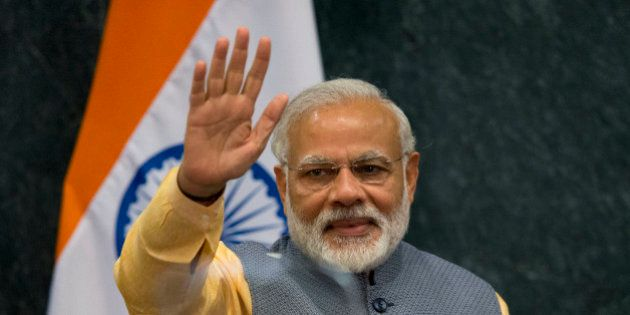 Prime Minister of India Narendra Modi waves following a joint statement to the press with Mexican President...