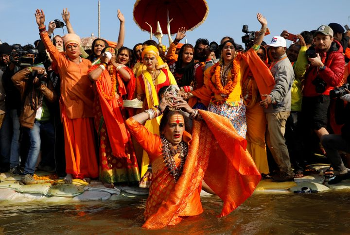 Lakshmi Narayan Tripathi, chief of the Kinnar Akhara congregation for transgender people, takes a dip during the first grand