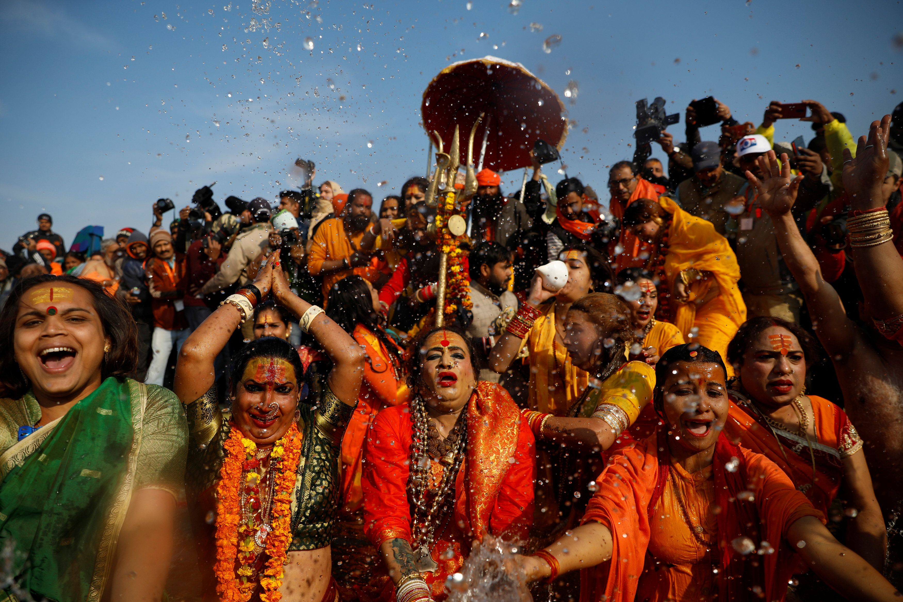 """Lakshmi Narayan Tripathi (C), chief of the """"Kinnar Akhada"""" congregation for transgender people and other members take a dip during the first """"Shahi Snan"""" (grand bath) at """"Kumbh Mela"""" or the Pitcher Festival, in Prayagraj, previously known as Allahabad, India, January 15, 2019. REUTERS/Danish Siddiqui"""