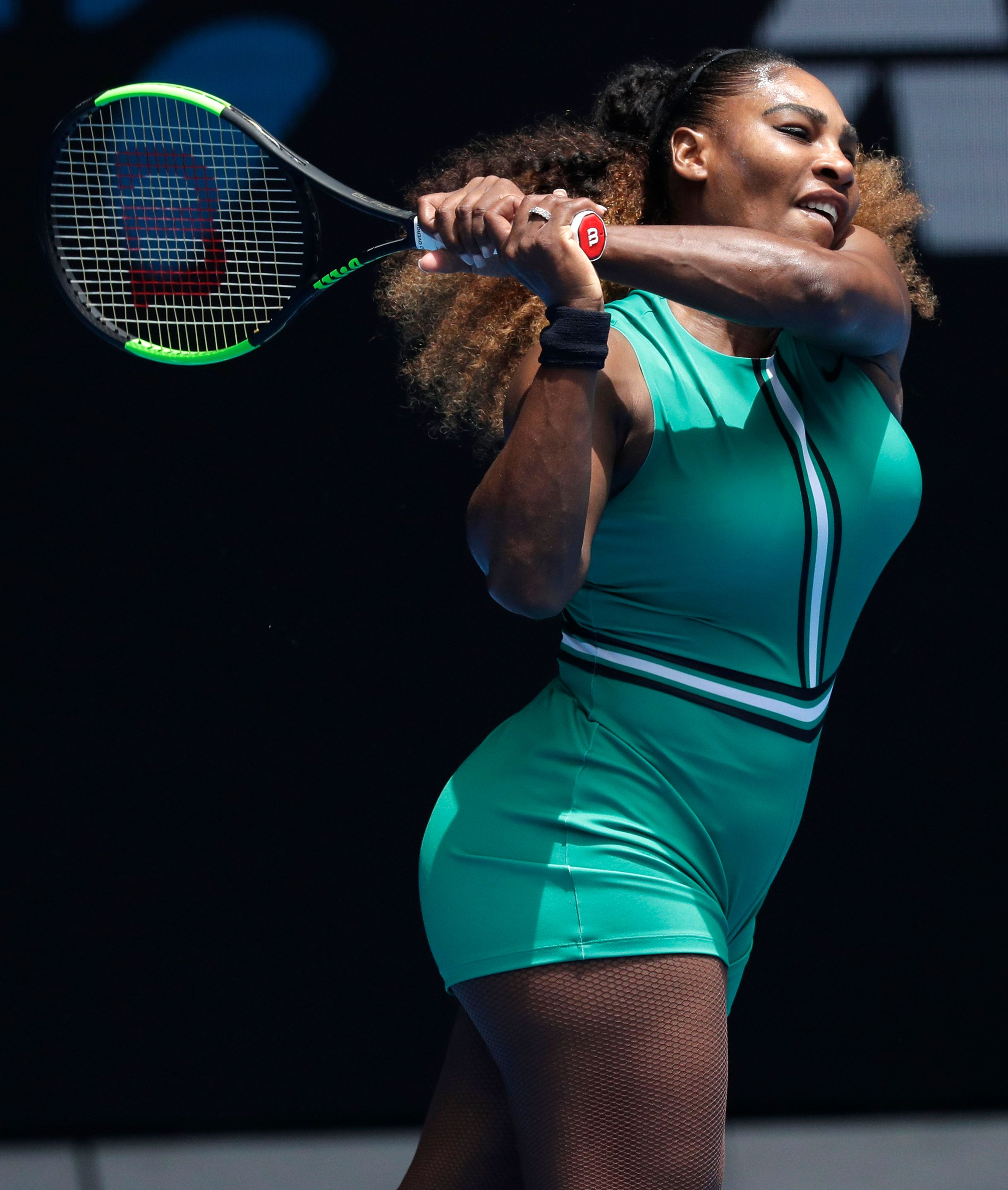 United States' Serena Williams hits a backhand return to Germany's Tatjana Maria during their first round match at the Australian Open tennis championships in Melbourne, Australia, Tuesday, Jan. 15, 2019. (AP Photo/Kin Cheung)