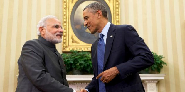 President Barack Obama shakes hands with Indian Prime Minister Narendra Modi, Tuesday, Sept. 30, 2014,...