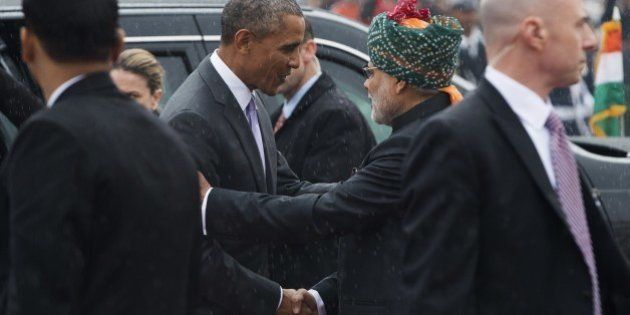 Indian Prime Minister Narendra Modi (2R) greets US President Barack Obama (2L) as he arrives to attend...