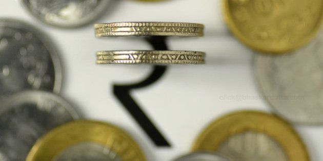 The rupee symbol with Indian coins