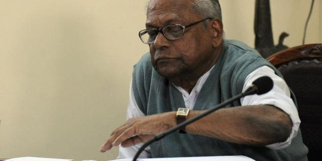 Kerala Chief Minister V.S. Achuthanandan reads a document during the Communist Party of India (Marxist)...