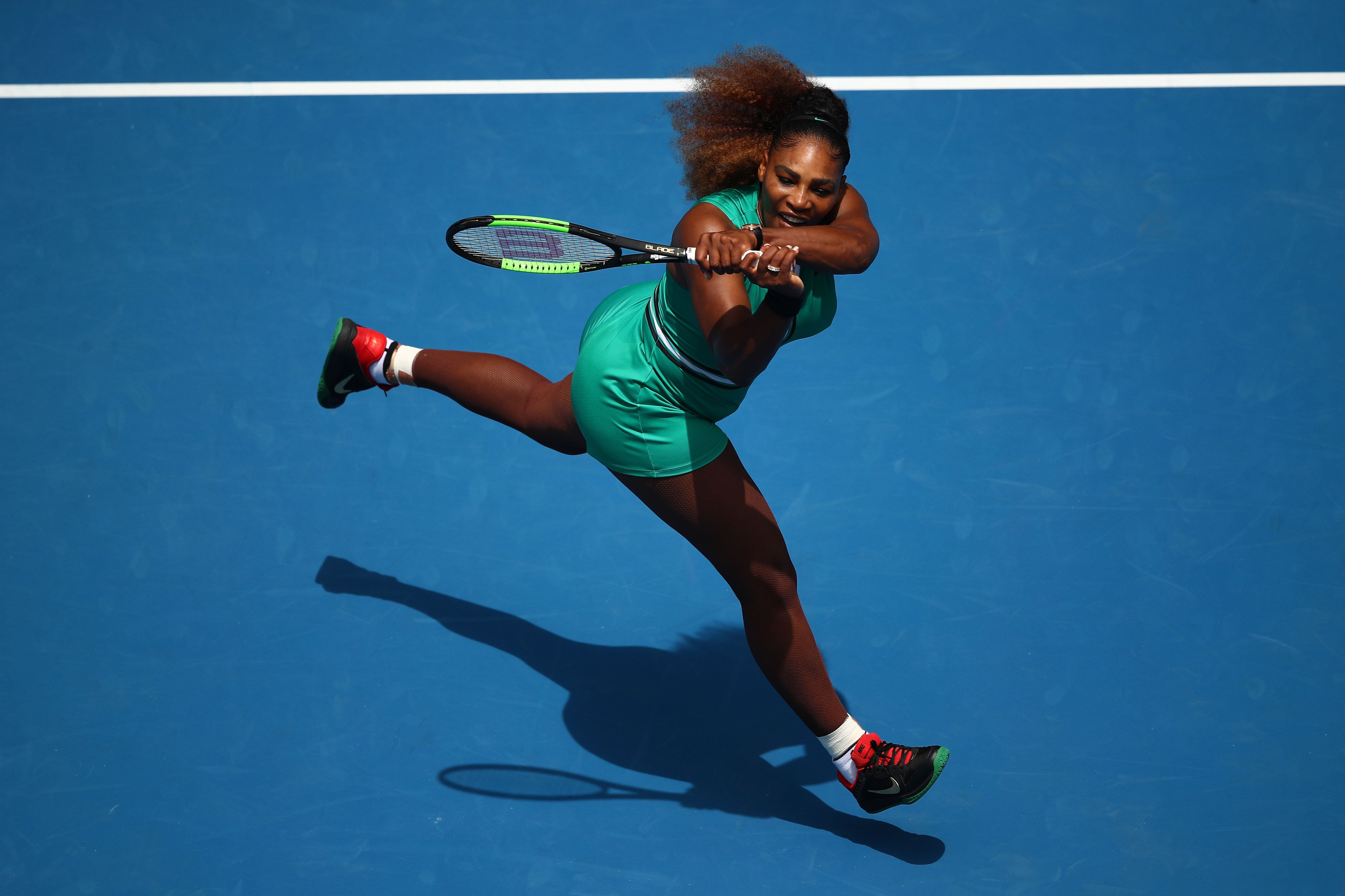 MELBOURNE, AUSTRALIA - JANUARY 15:  Serena Williams of the United States plays a backhand in her first round match against Tatjana Maria of Germany during day two of the 2019 Australian Open at Melbourne Park on January 15, 2019 in Melbourne, Australia.  (Photo by Julian Finney/Getty Images)