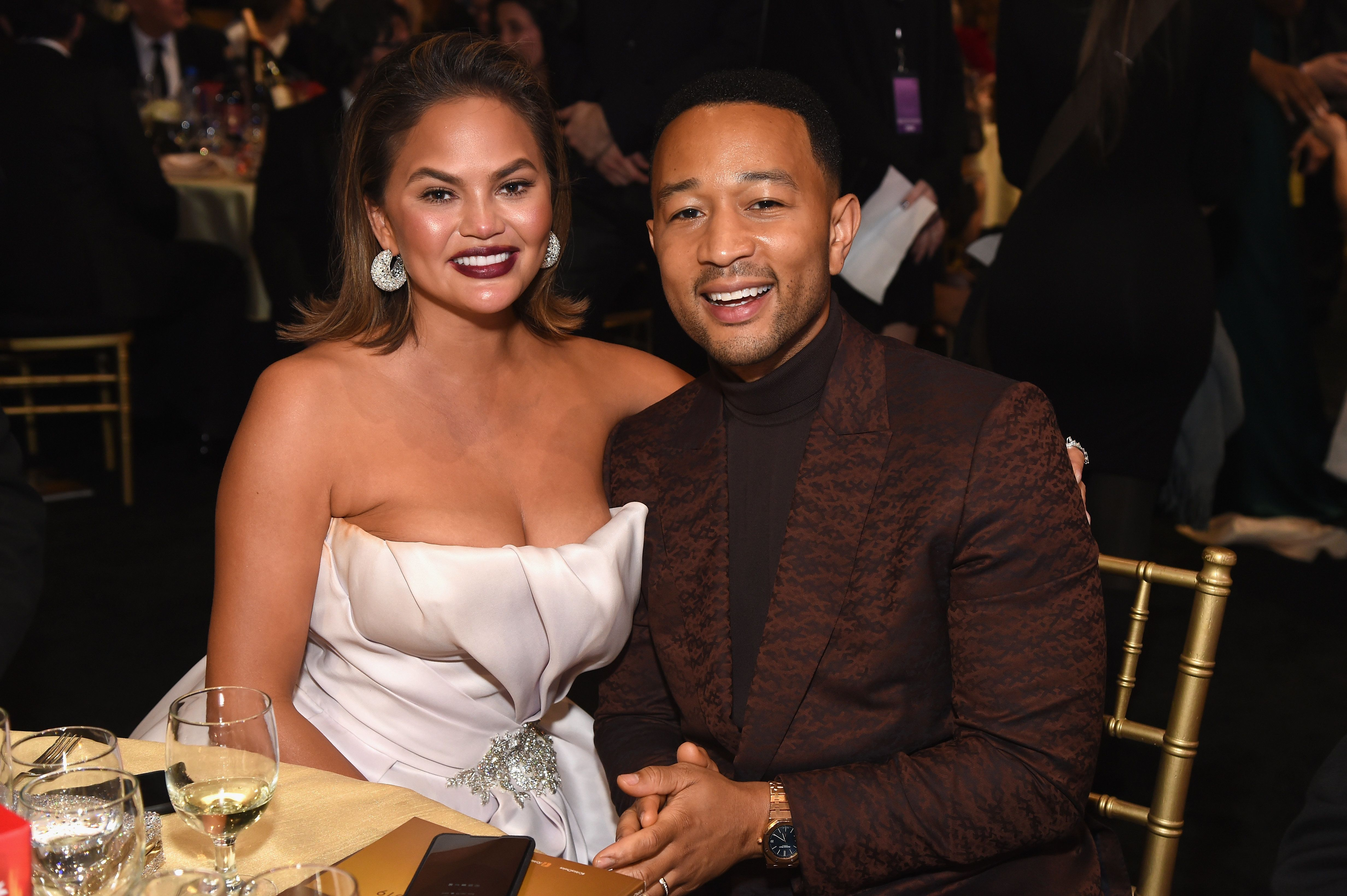 SANTA MONICA, CA - JANUARY 13:  Chrissy Teigen (L) and John Legend attend the 24th annual Critics' Choice Awards at Barker Hangar on January 13, 2019 in Santa Monica, California.  (Photo by Michael Kovac/WireImage)