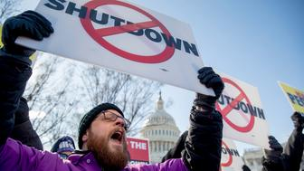 "The Capitol Dome is visible behind Grant Mulkey with the National Air Traffic Controllers Association and others who hold signs and shout in unison to open the government ""NOW!"" as a call and response as Air Traffic and pilot unions protest the government shutdown on Capitol Hill in Washington, Thursday, Jan. 10, 2019. (AP Photo/Andrew Harnik)"