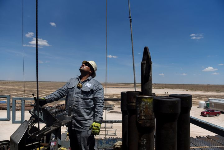 A contractor works on a drilling site in the Permian Basin, a massive field stretching from Texas to New Mexico.