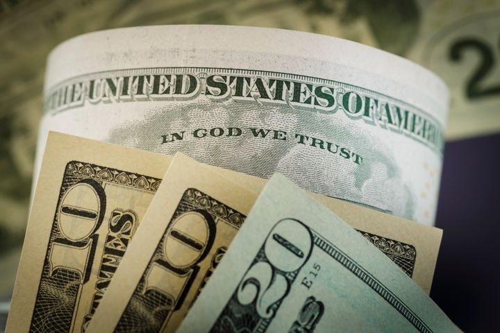 "The phrase ""In God We Trust,"" seen on a U.S. dollar bill, became the national motto in 1956."