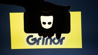 The logo of the dating app Grindr is seen on a mobile screen and a laptop screen. Grindr is a dating app for gay, bi, pan and curious men. Several Millions use Dating Apps every day.  (Photo by Alexander Pohl/NurPhoto via Getty Images)