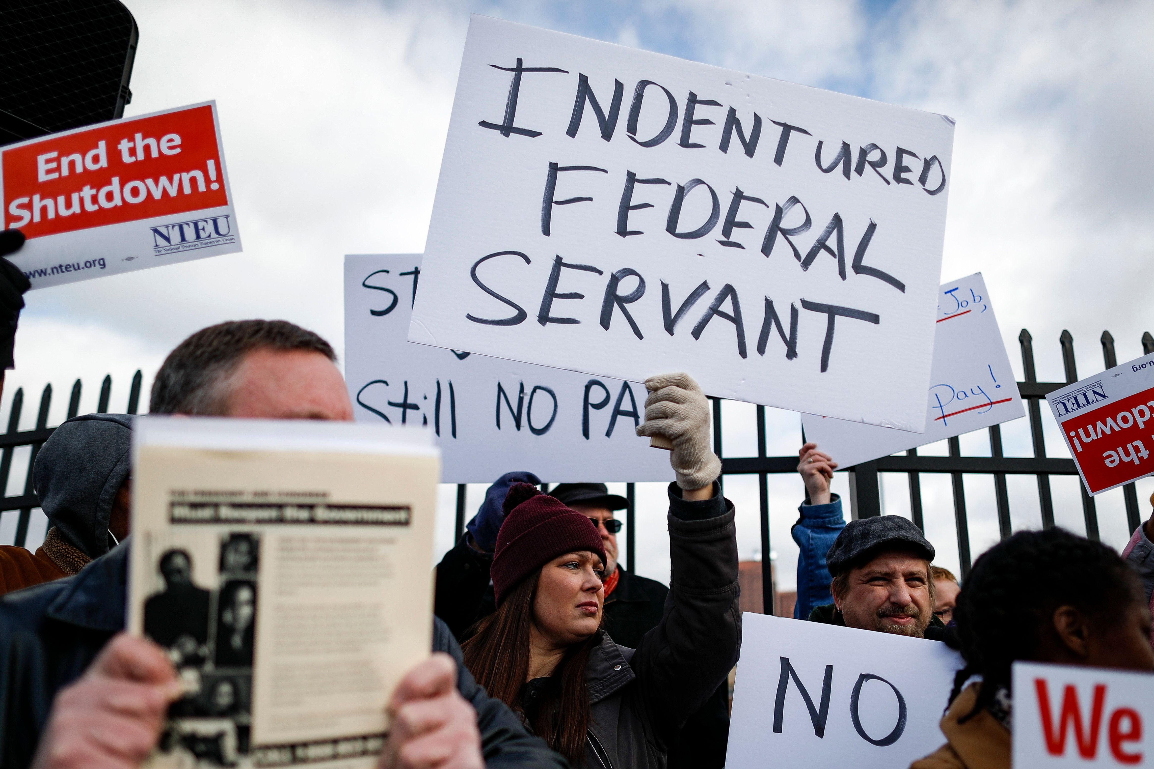 Union members and Internal Revenue Service workers rally outside an IRS Service Center to call for an end to the partial government shutdown, Thursday, Jan. 10, 2019, in Covington, Ky. (AP Photo/John Minchillo)