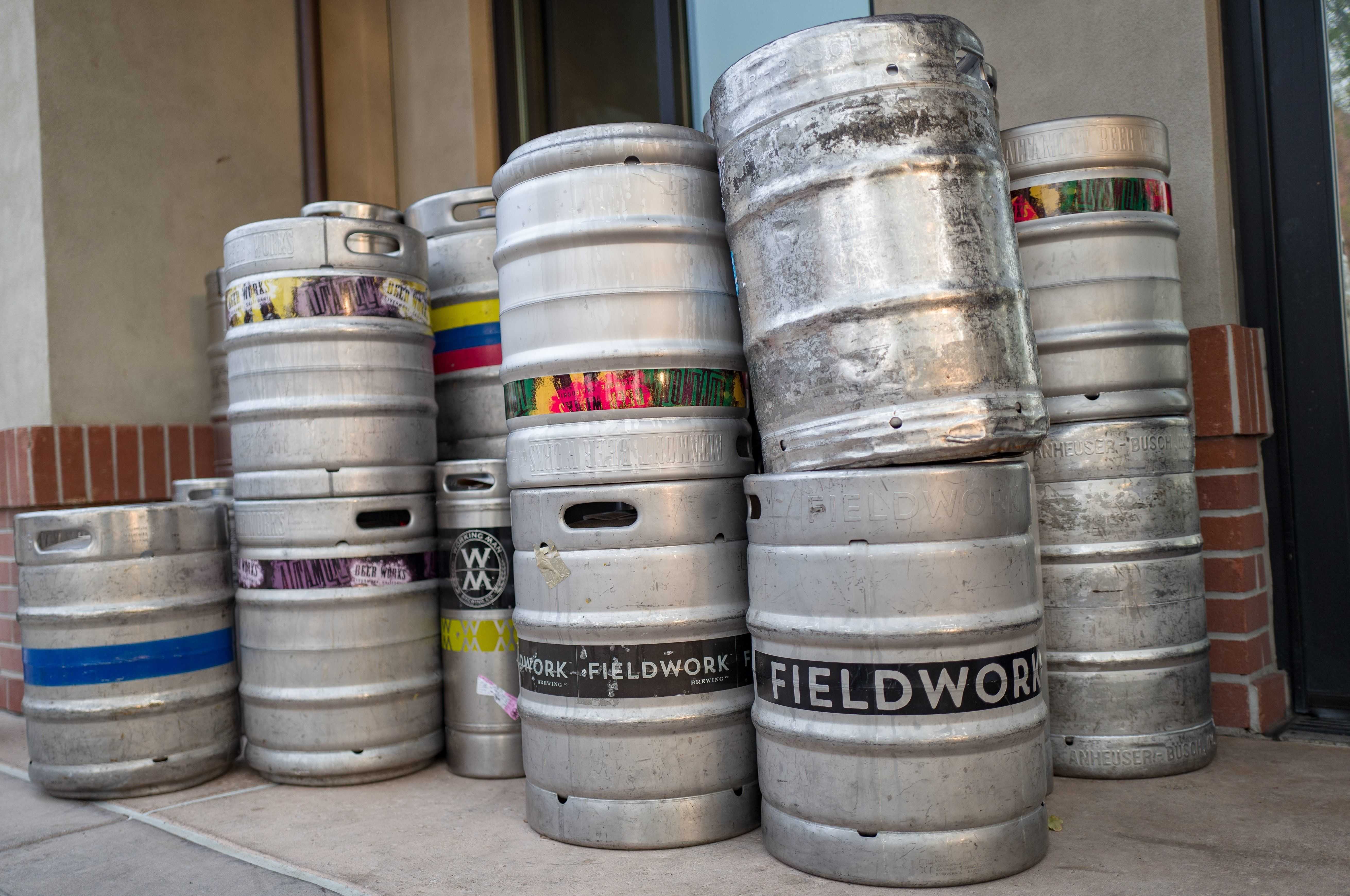 Low-angle view of stack of kegs containing craft brew beer from microbreweries including Fieldwork, in downtown Livermore, California, November 19, 2018. (Photo by Smith Collection/Gado/Getty Images)