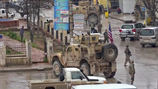 An image grab taken from a video obtained by AFPTV on January 16, 2019, shows US troops gathered at the scene of a suicide attack in the northern Syrian town of Manbij. - A suicide attack targeting US-led coalition forces in the flashpoint northern Syrian city of Manbij killed a US serviceman and 14 other people today, a monitor said. (Photo by - / various sources / AFP)        (Photo credit should read -/AFP/Getty Images)