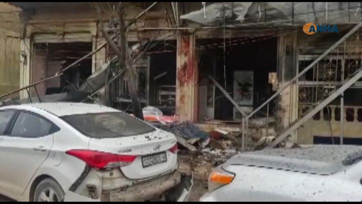An image grab taken from a video published by Hawar News Agency (ANHA) on January 16, 2019, shows the aftermath of a suicide