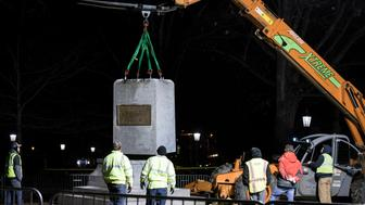 "The first and largest piece of the remnants of a Confederate statue known as ""Silent Sam"" is lifted before being transported to the bed of a truck early Tuesday,  Jan. 15, 2019 on the campus of the University of North Carolina in Chapel Hill, N.C.  The last remnants of the statue were removed  at the request of UNC-Chapel Hill Chancellor Carol Folt, who also announced her resignation in a move that increases pressure on the system's board of governors to give up on plans to restore the monument. (Julia Wall/The News & Observer via AP)"