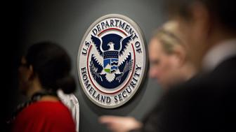 The U.S. Immigration and Customs Enforcement (ICE) seal hangs on a wall before a speech by U.S. Vice President Mike Pence, not pictured, at the agency headquarters in Washington, D.C., U.S., on Friday, July 6, 2018. The U.S. will return immigrant children under five who were separated from their parents after crossing the Mexican border by July 10 to comply with a court order, the Health and Human Services Secretary said Thursday. Photographer: Andrew Harrer/Bloomberg via Getty Images