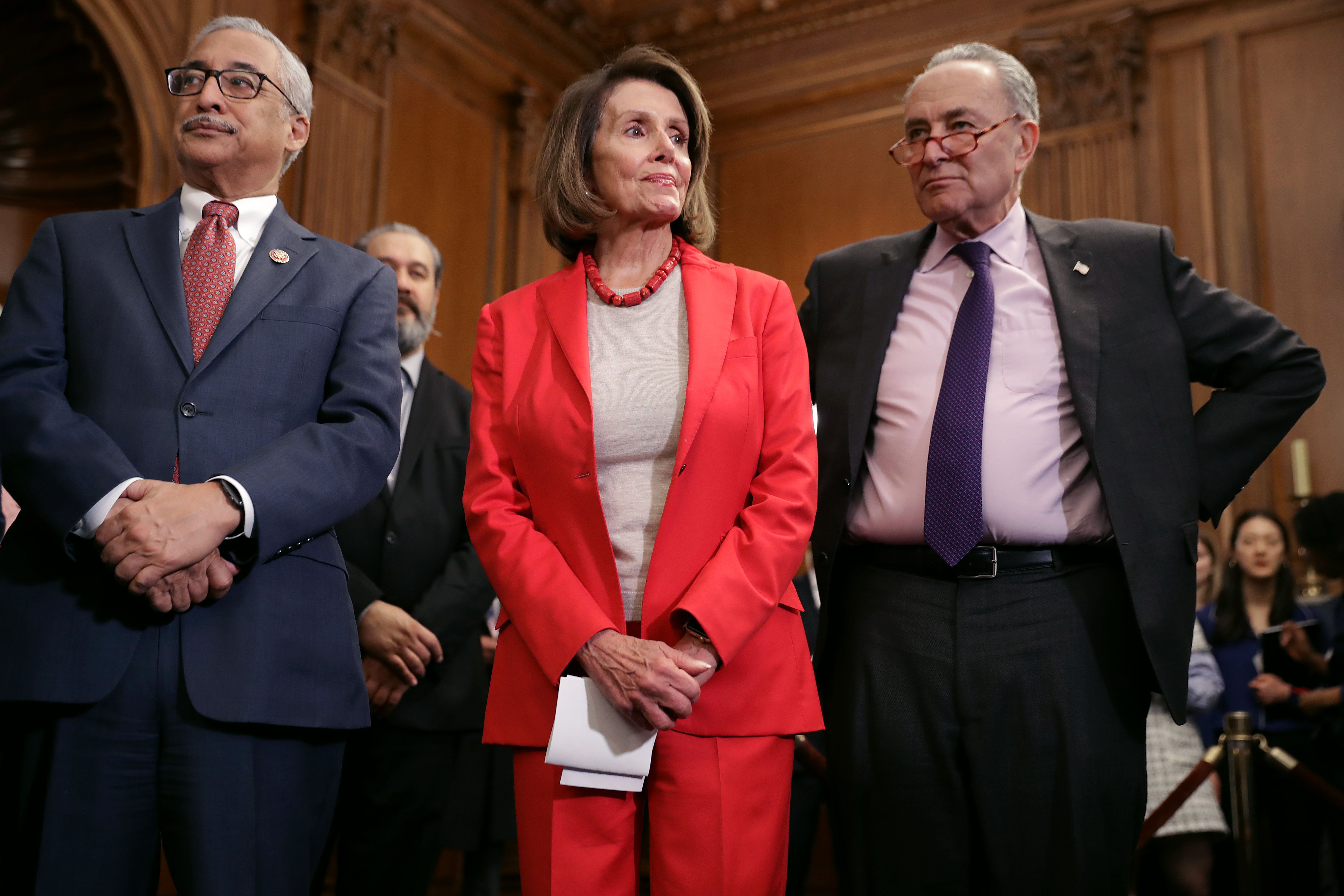 WASHINGTON, DC - JANUARY 16: (L-R) House Education and Labor Chairman Bobby Scott (D-VA), Speaker of the House Nancy Pelosi (D-CA) and Senate Minority Leader Charles Schumer (D-NY) attend an event to introduce the Raise The Wage Act in the Rayburn Room at the U.S. Capitol January 16, 2019 in Washington, DC. The proposed legislation, which will gradually raise the minimum wage to $15 by 2024, is unlikely to pass in the Republican-controlled Senate. (Photo by Chip Somodevilla/Getty Images)