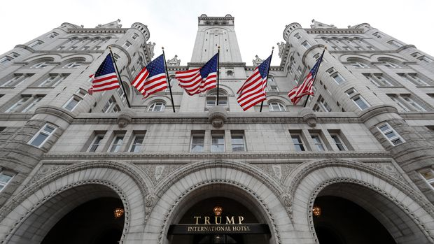 FILE - In this Dec. 21, 2016, file photo The Trump International Hotel at 1100 Pennsylvania Avenue NW, is seen in Washington. Celebrity chef Jose Andres has settled his dispute with The Trump Organization after backing out of a plan to open a restaurant in Washington's Trump hotel. Andres' ThinkFoodGroup and The Trump Organization issued a statement Friday, April, 7, 2017, saying the lawsuit has been settled. The deal's terms are confidential. (AP Photo/Alex Brandon, File)