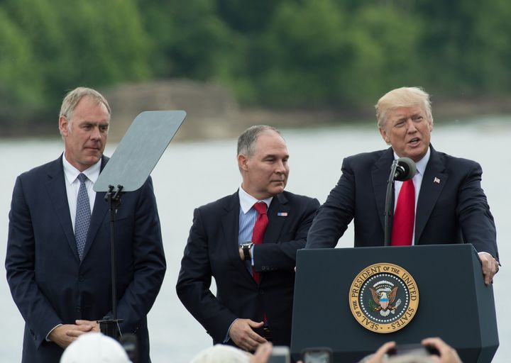 Trump and his initial appointees to run the Interior Department and the EPA — Ryan Zinke (left) and Scott Pruitt (cente