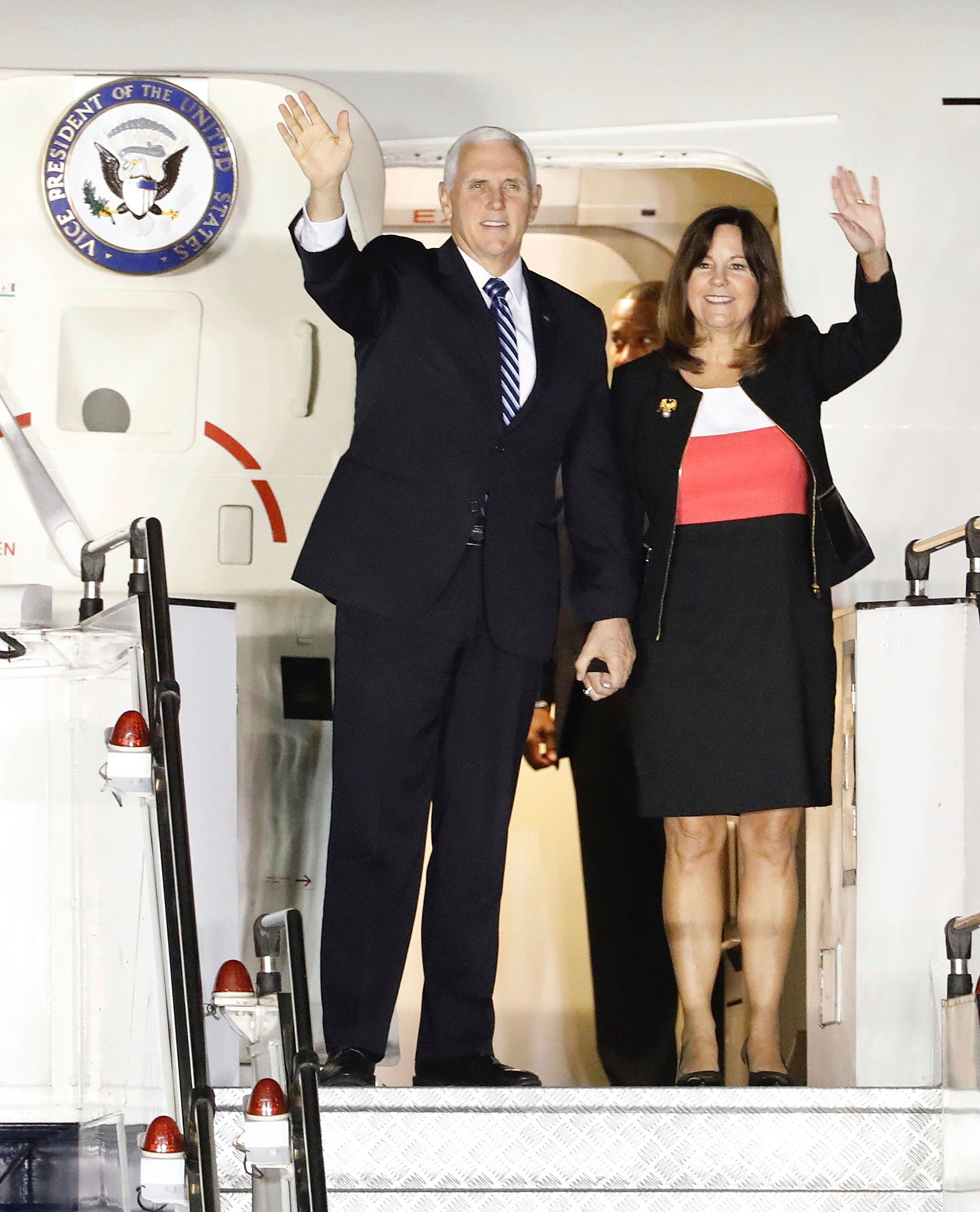 U.S. Vice President Mike Pence and his wife Karen wave during their arrival at Paya Lebar Airbase in Singapore, Tuesday, Nov. 13, 2018. Pence is in Singapore to attend the 33rd ASEAN summit. (AP Photo/Bernat Armangue)