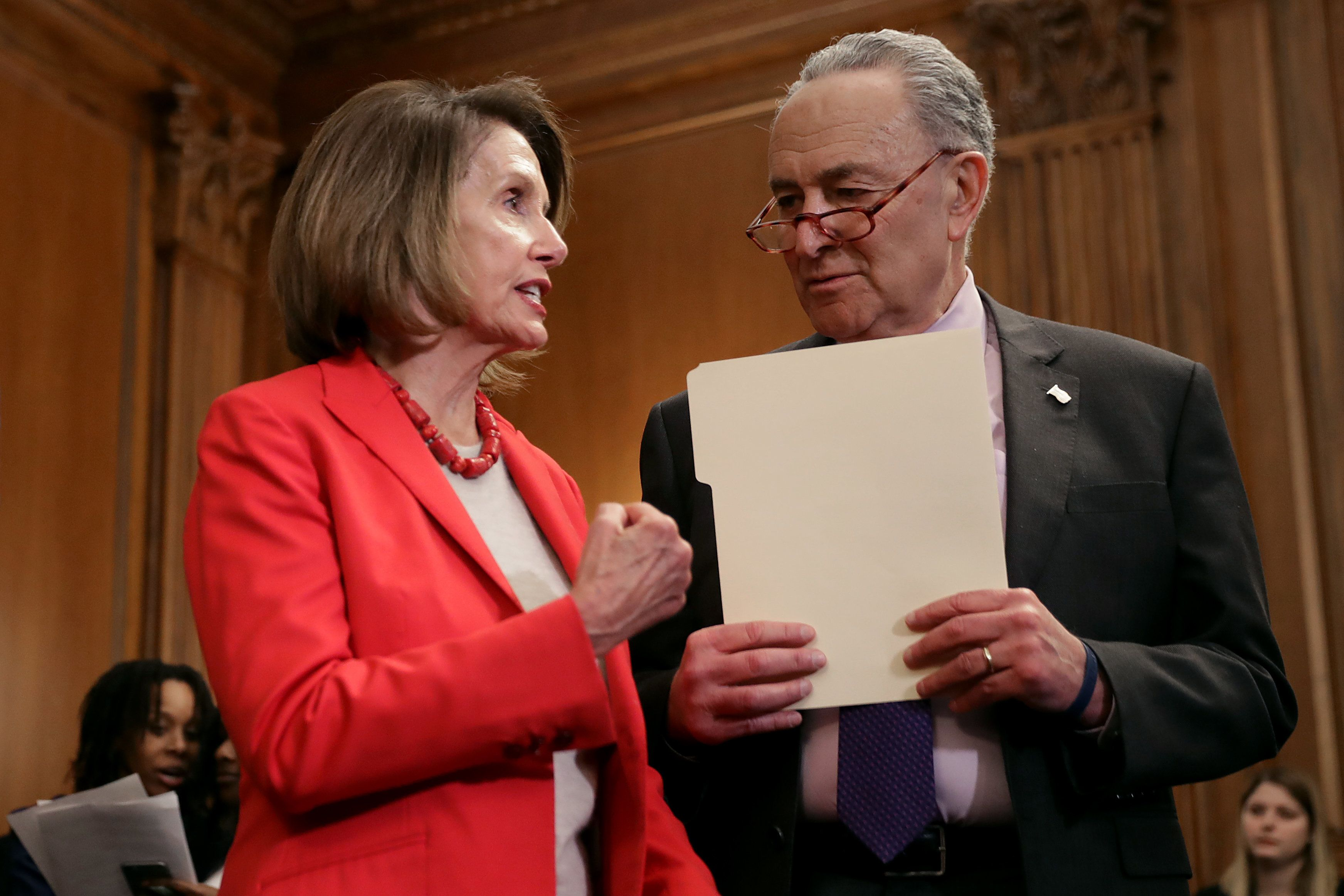 WASHINGTON, DC - JANUARY 16: Speaker of the House Nancy Pelosi (D-CA) (L) and Senate Minority Leader Charles Schumer (D-NY) talk during an event to introduce the Raise The Wage Act in the Rayburn Room at the U.S. Capitol January 16, 2019 in Washington, DC. The proposed legislation, which will gradually raise the minimum wage to $15 by 2024, is unlikely to pass in the Republican-controlled Senate. (Photo by Chip Somodevilla/Getty Images)