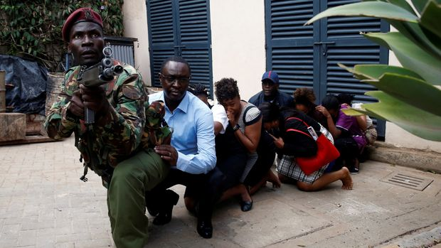 People are evacuated by a member of security forces at the scene where explosions and gunshots were heard at the Dusit hotel compound, in Nairobi, Kenya, Jan.15, 2019. (Photo: Baz Ratner/Reuters)