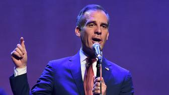Los Angeles Mayer Eric Garcetti addresses the audience at The Last Weekend Rally presented by Swing Left at the Palace Theatre, Thursday, Nov. 1, 2018, in Los Angeles. The event was organized by the progressive Swing Left political group, with the aim of spurring get-out-the-vote efforts on the last weekend before the midterm elections. (Photo by Chris Pizzello/Invision/AP)