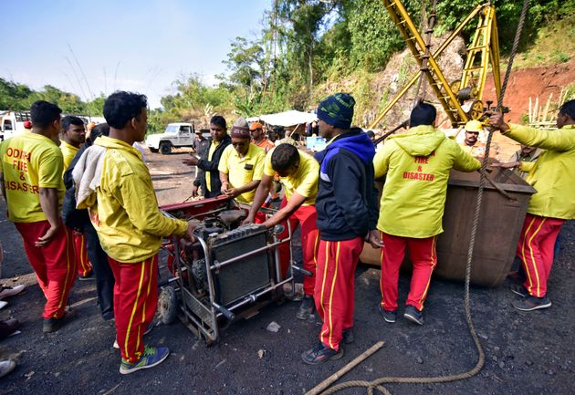 Rescuers prepare a water pump at the site of a coal mine that collapsed in Ksan, in Meghalaya, 29 December