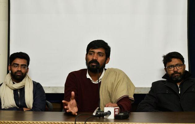 Ex-ABVP member Pradeep Narwal (C) speaks to the media in the presence of ex-ABVP member Jatin Goraya...