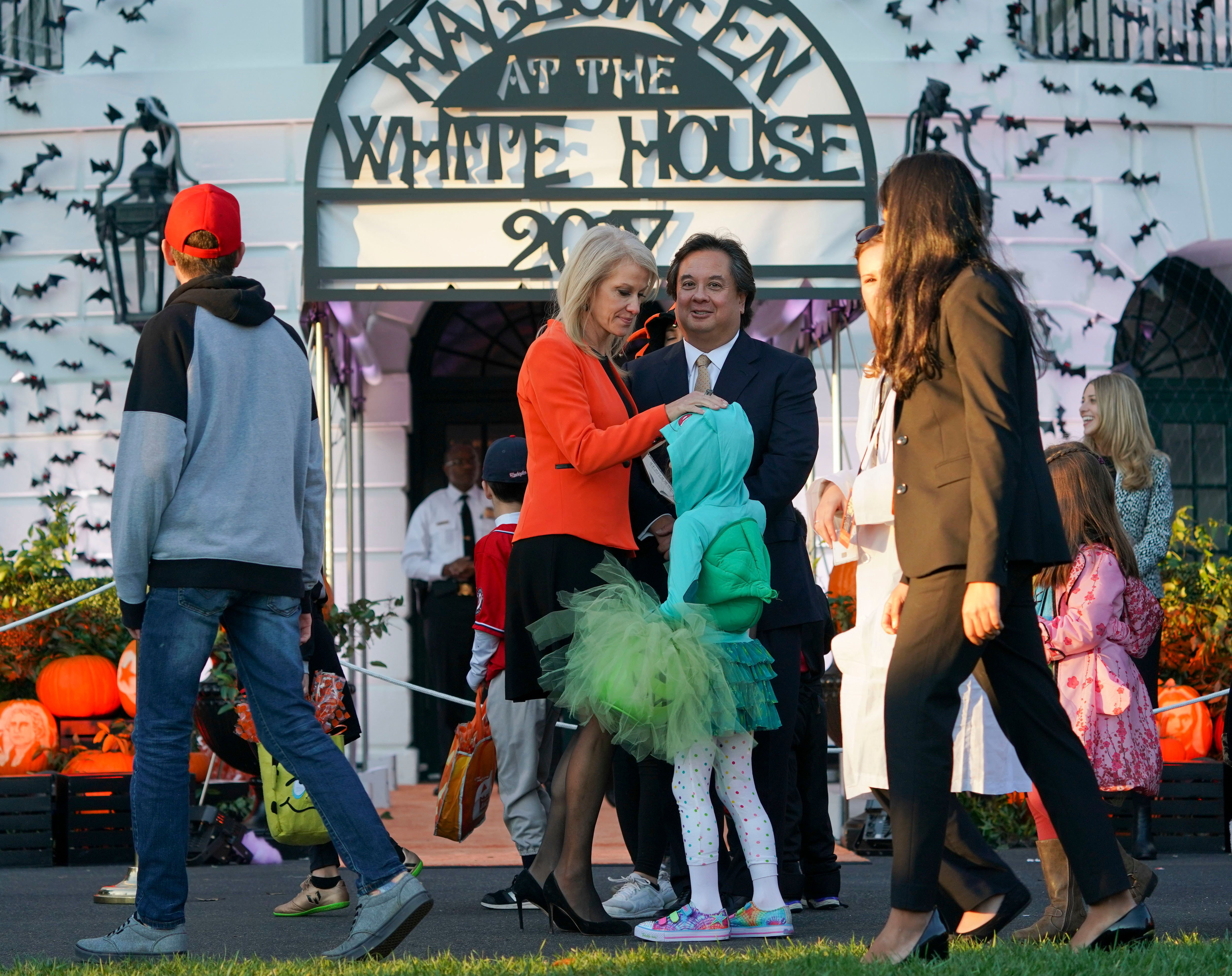 Counselor to the President Kellyanne Conway, center, and her husband George Conway, right, greet guests on the South Lawn of the White House in Washington during a Halloween event welcoming children from the Washington area and children of military families to trick-or-treat, Monday, Oct. 30, 2017. (AP Photo/Pablo Martinez Monsivais)