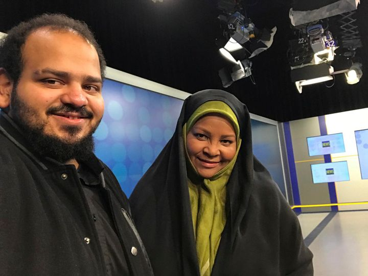 American-born news anchor Marzieh Hashemi, right, smiles as she stands with her son in Tehran, Iran, in this undated photo pr