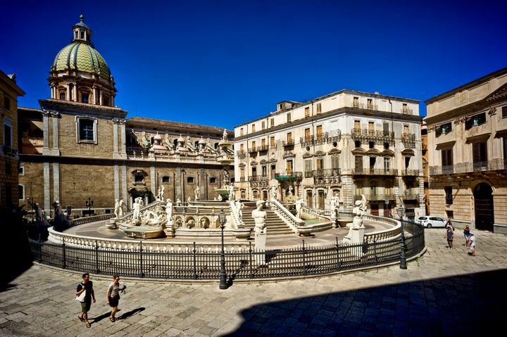 Piazza Pretoria in Palermo features a gorgeous fountain and several statues.