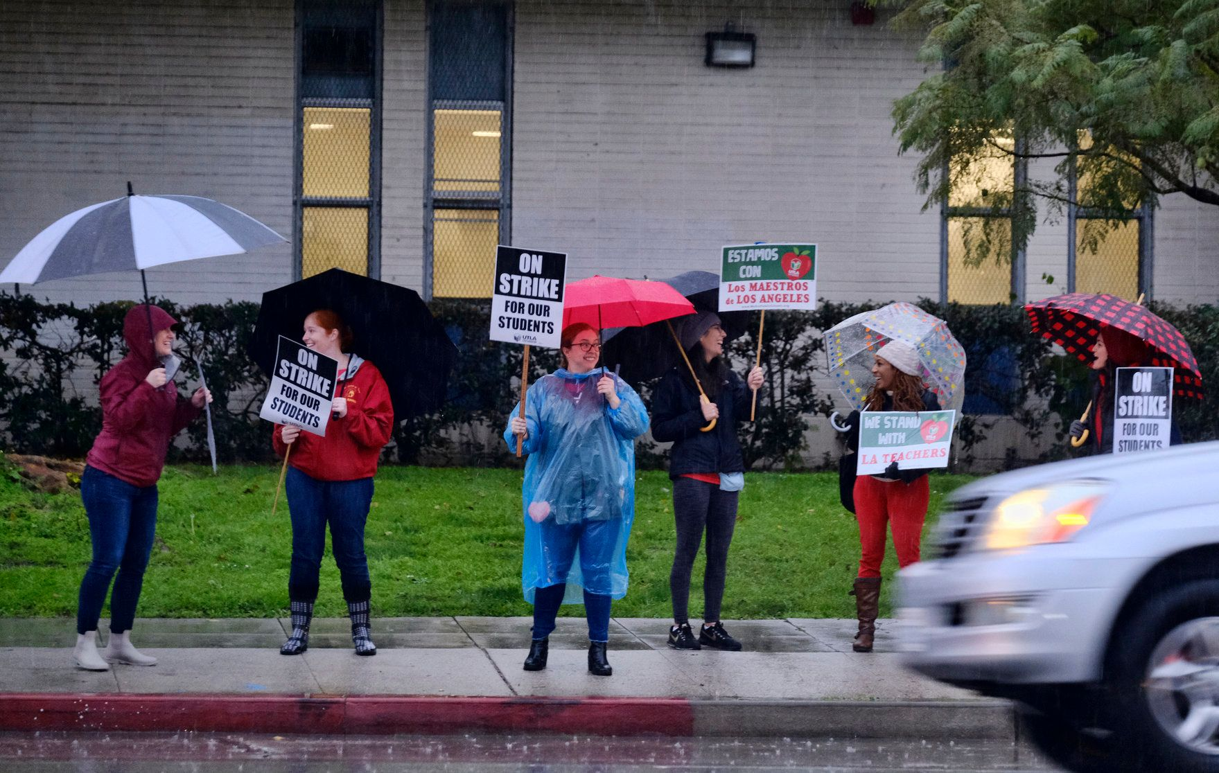 A driver honks the horn in support while passing teachers picketing during a city-wide teacher strike in front of Los Angeles High School on Monday, Jan. 14, 2019. Tens of thousands of Los Angeles teachers went on strike Monday after contentious contract negotiations failed in the nation's second-largest school district. (AP Photo/Richard Vogel)
