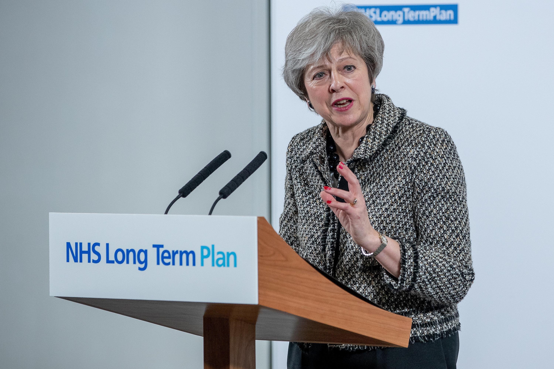 Theresa May announcing the NHS long term plan earlier this