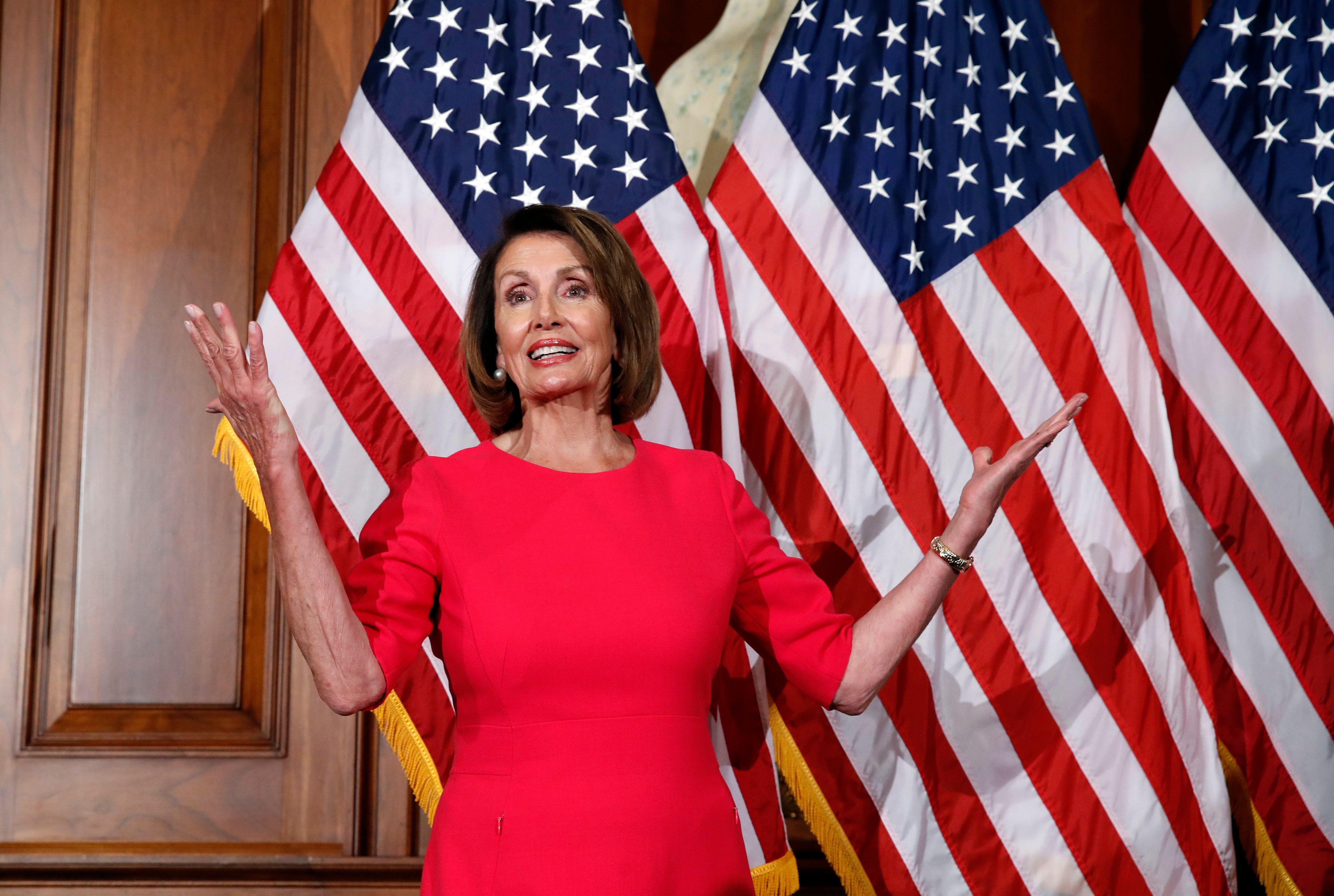 """In this Jan. 3, 2019, photo, House Speaker Nancy Pelosi of Calif., gestures before a ceremonial swearing-in on Capitol Hill in Washington, during the opening session of the 116th Congress. House Democrats are unveiling a comprehensive elections and ethics reform package that takes aim at what they call """"the culture of corruption in Washington"""" and reduces the role of money in politics. (AP Photo/Alex Brandon)"""