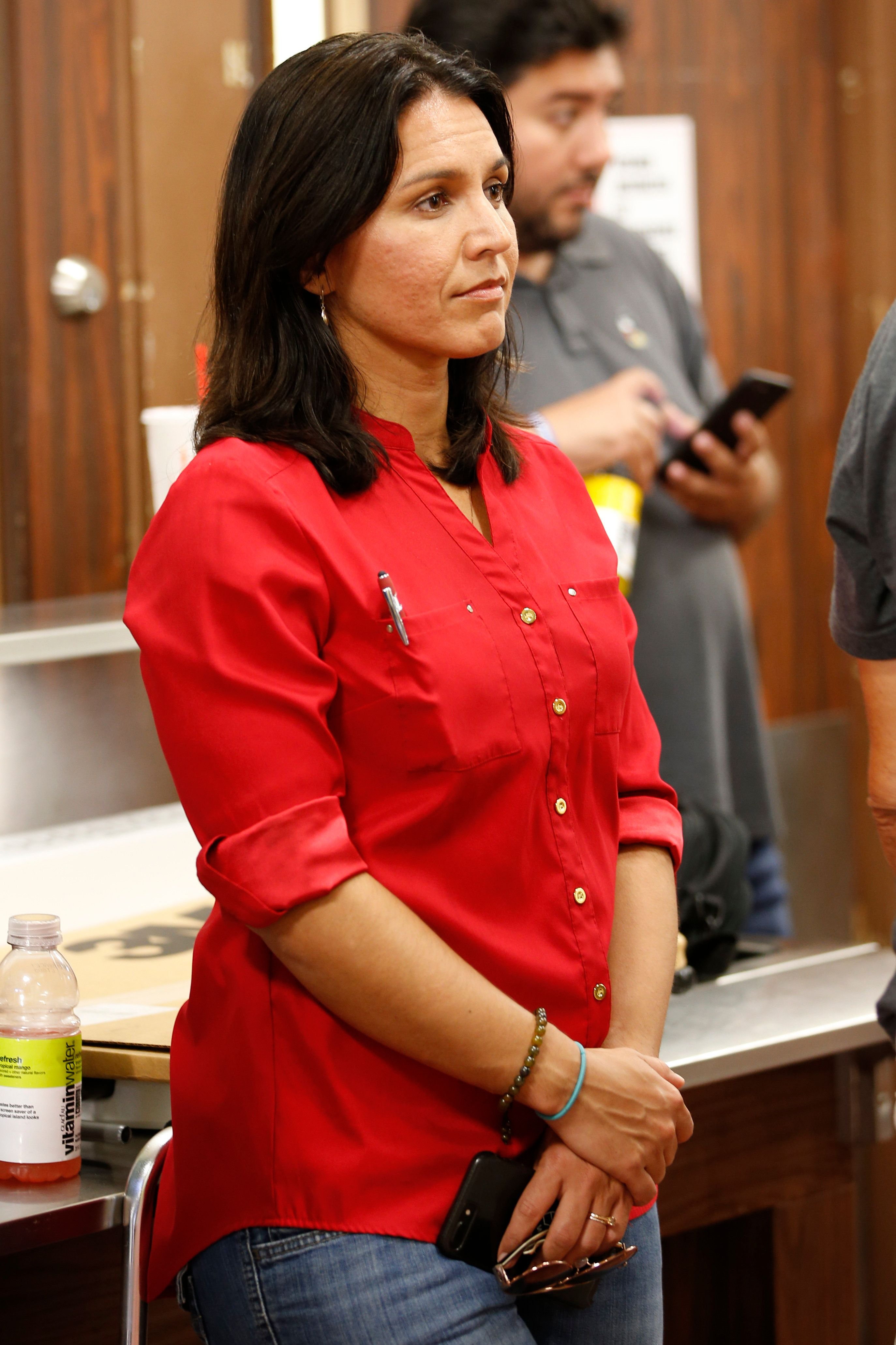 US Rep. Tulsi Gabbard, D-Hawaii, attends a community meeting at Pahoa High School, Friday, May 4, 2018, in Pahoa, Hawaii. Gabbard, who serves in the National Guard, will be activated tomorrow and will serve in the lava affected areas of the Big Island. (AP Photo/Marco Garcia)