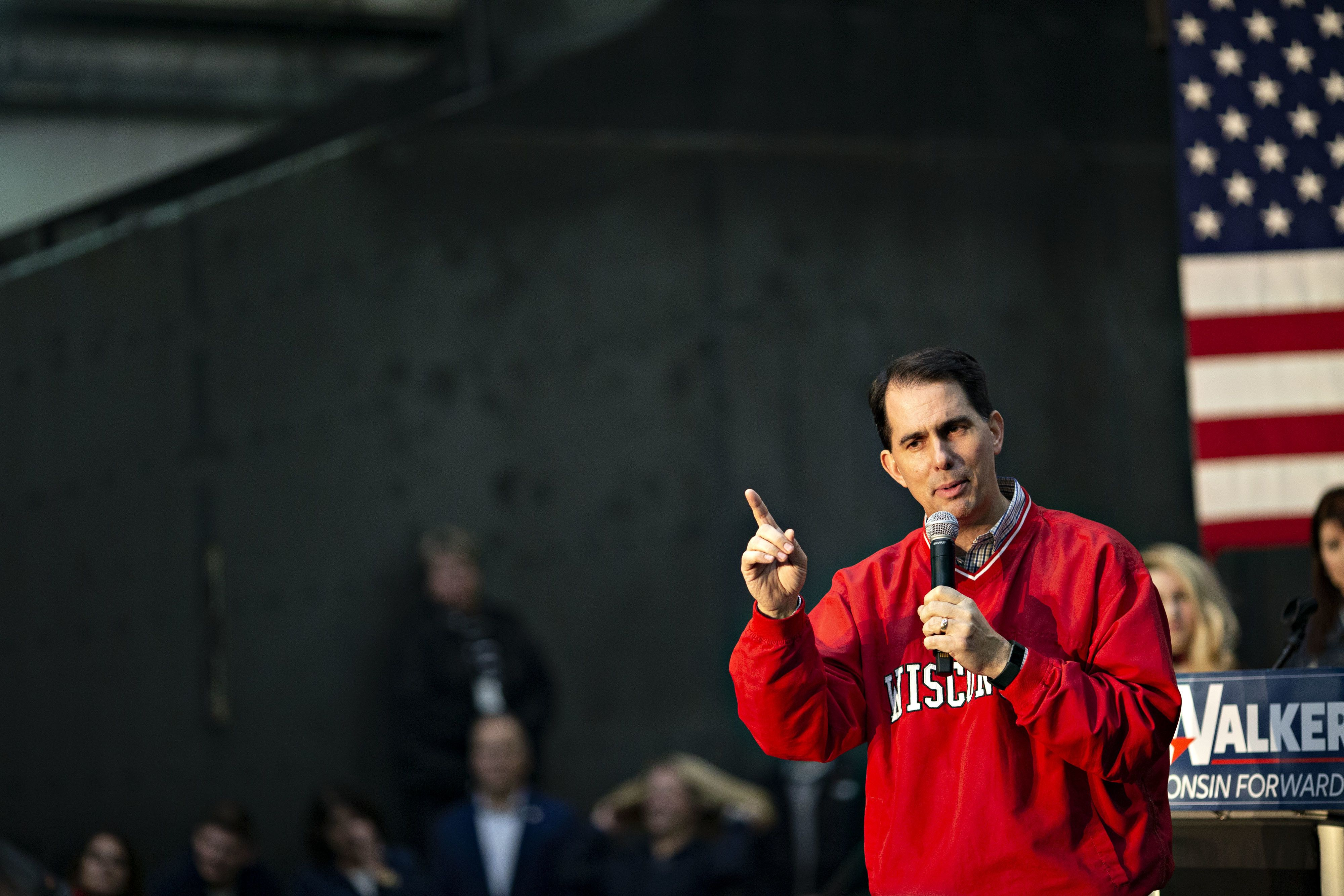 Scott Walker, governor of Wisconsin, speaks during a campaign rally at Weldall Manufacturing Inc., in Waukesha, Wisconsin, U.S., on Monday, Nov. 5, 2018. The most expensive midterm campaign in U.S. history raced to a finish ahead of Tuesday's elections, as both sides braced for a possible split decision that would hand the House to Democrats and leave Republicans holding onto or expanding their Senate majority. Photographer: Daniel Acker/Bloomberg via Getty Images