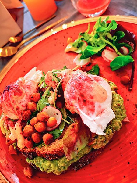 Avocado and eggs with spiced chickpeas and halloumi at Brother Hubbard North.