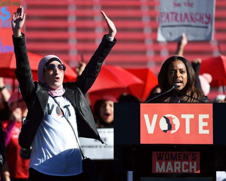Women's March leaders Linda Sarsour, left, and Tamika Mallory have struggled to defend the national organization against alle