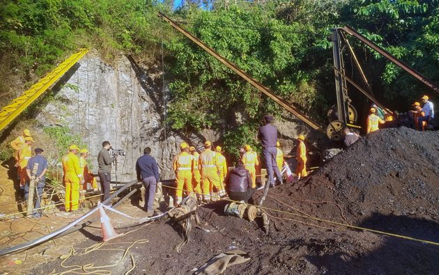 Rescuers work at the site of the collapsed coal